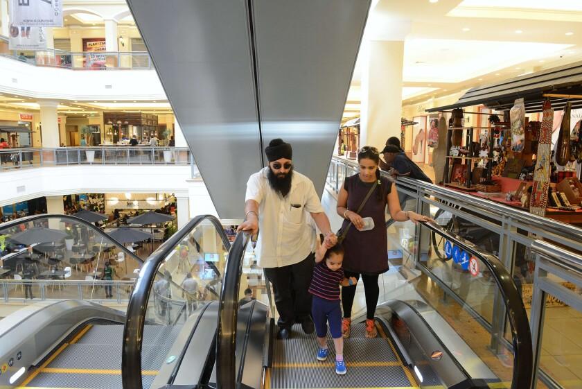 Customers shop in the reopened Westgate mall in Nairobi, Kenya.