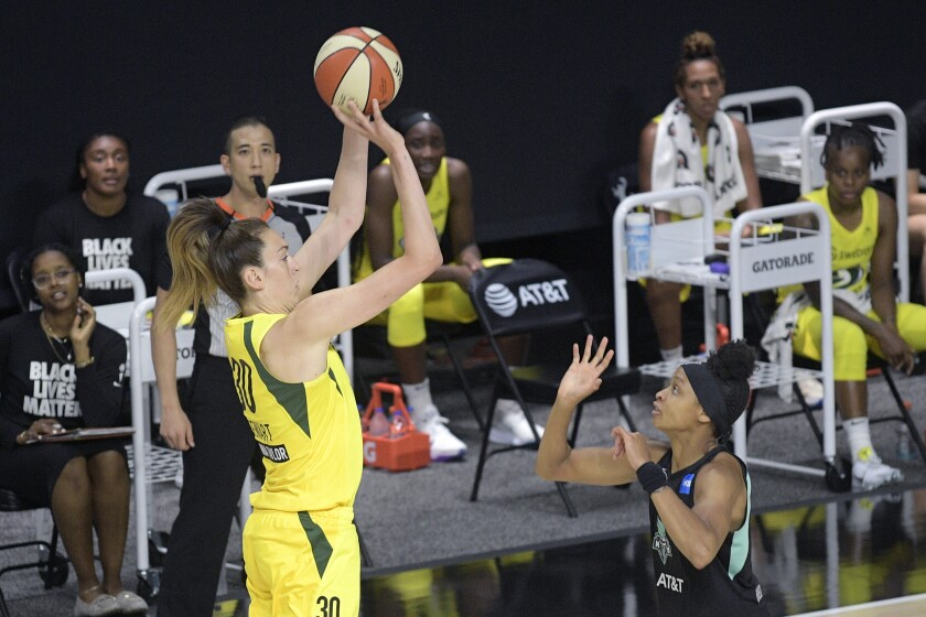 Seattle Storm forward Breanna Stewart goes up for a shot in front of New York Liberty's Leaonna Odom on Saturday.