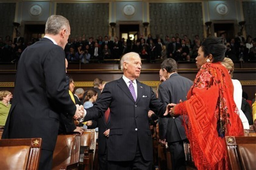 Vice President Joe Biden enters the House chamber and greets Rep. Sheila Jackson Lee, D-Texas, before President Barack Obama delivered the State of the Union address on Capitol Hill in Washington, Wednesday, Jan. 27, 2010. (AP Photo/Tim Sloan, Pool)