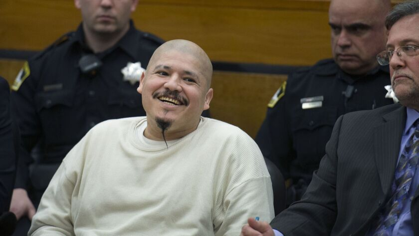 "Luis Bracamontes smiles as he is sentenced to death in the murders of two law enforcement officers. Footage of the court appearance was used in a video posted by President Trump to encourage constituents to ""vote Republican."""