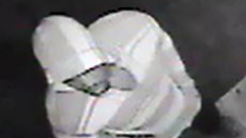 Police released images of the suspect taken from Superior Liquor store's surveillance camera.