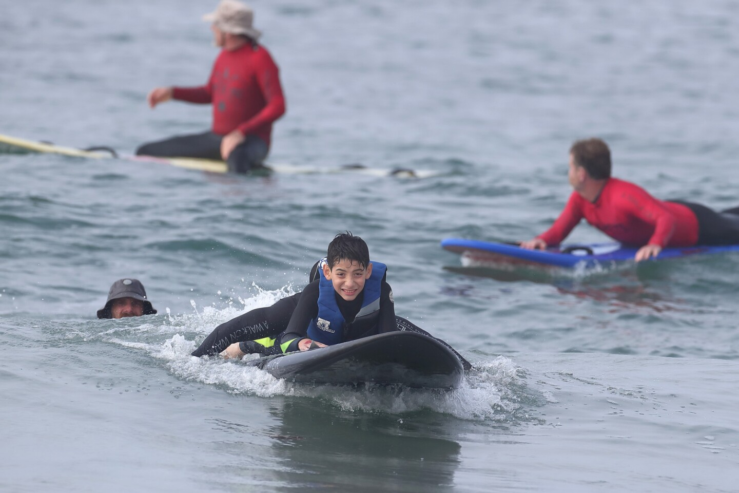 The surf students had lot of volunteer help at the Walk on Water event