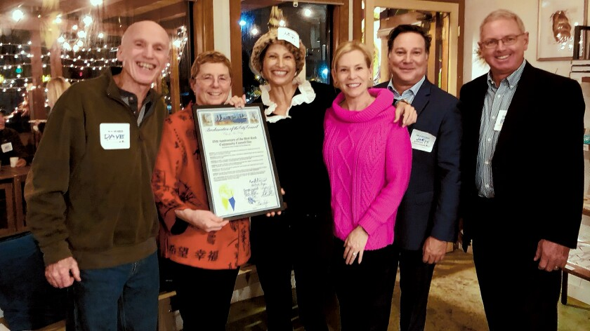 Showing off the City of San Diego's 'Dec. 3, 2019 is 25th Anniversary of Bird Rock Community Council Day' proclamation plaque are BRCC board members David and Barbara Dunbar, Tiffany Chow, Kristin Barret and Joe Parker with City Council District 1 representative Steve Hadley.