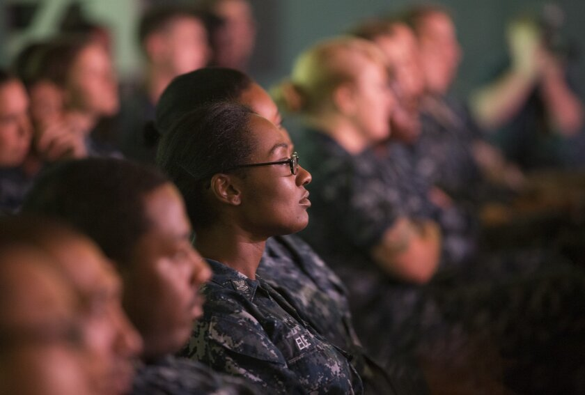 In San Diego, sailors and Marines aboard the amphibious ship Makin Island watch a program about sexual assault prevention.