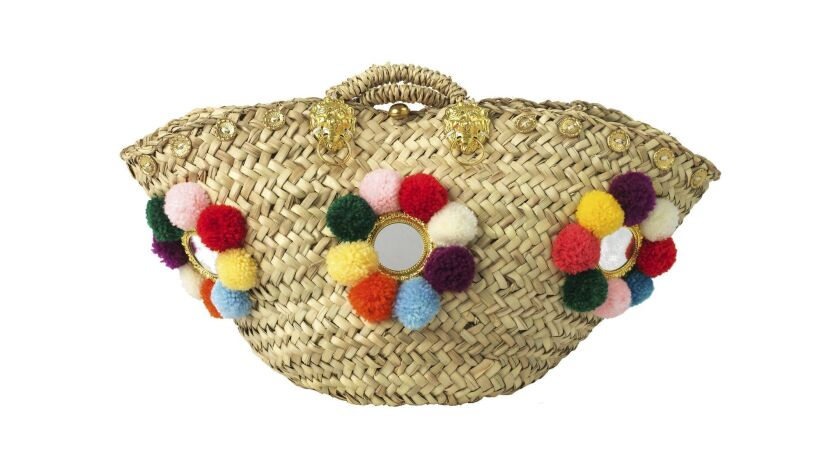 "The handmade Sicilian Basket by Muzungu Sisters is a traditional ""coffa"" basket that adds interest t"
