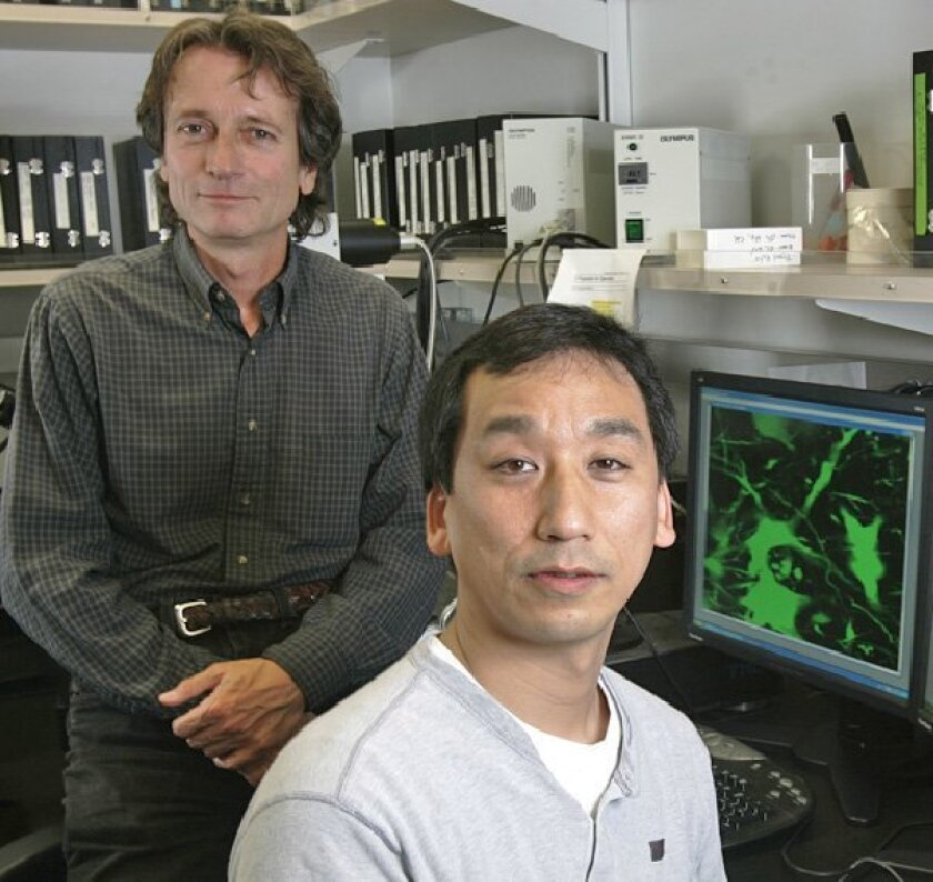 Dr. Mark Tuszynski (left) and colleague Ken 