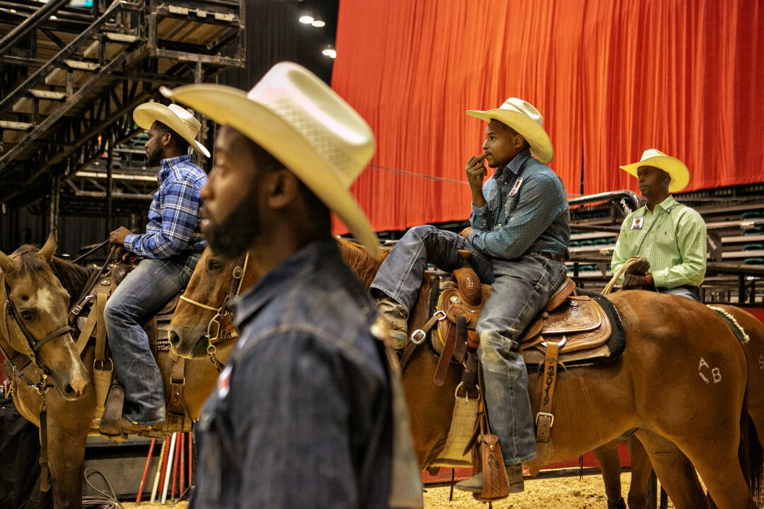 Cowboys watch and wait their turns