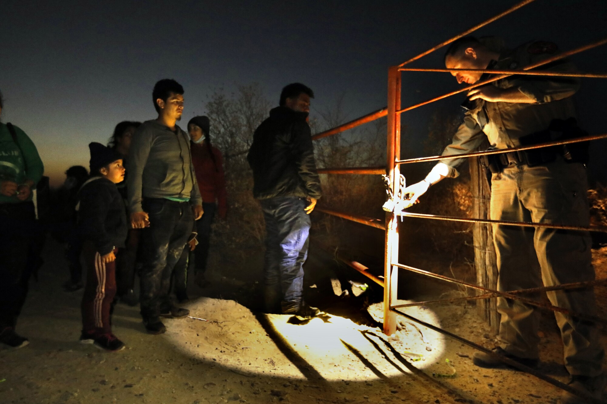 Asylum seekers wait for directions from Border Patrol agents