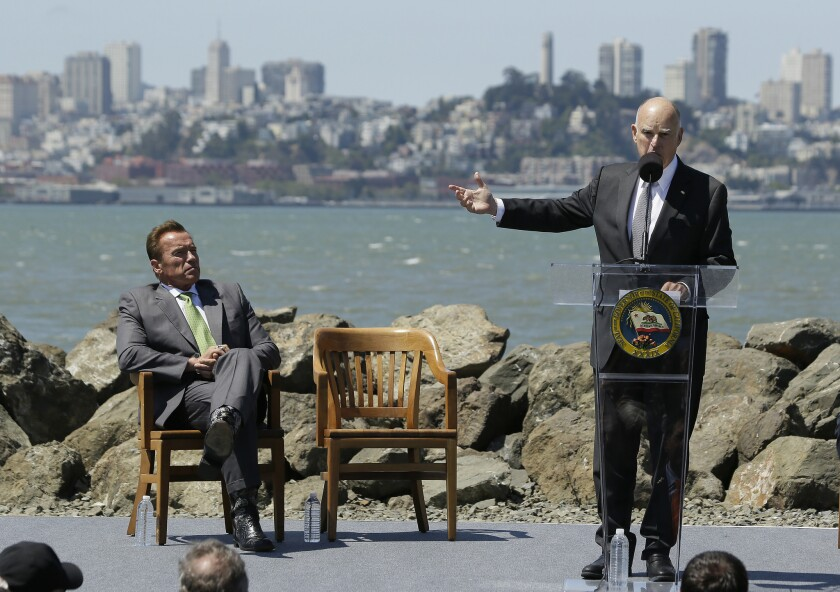 California Gov. Jerry Brown with Arnold Schwarzenegger.