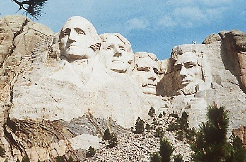 Mt. Rushmore, with sculpted images of George Washington, Thomas Jefferson, Theodore Roosevelt and Abraham Lincoln.