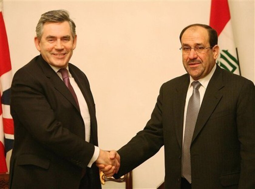 Britain's Prime Minister Gordon Brown, left, shakes hands with with Iraq's Prime Minister Nouri al-Maliki, right, in Baghdad, Iraq, Wednesday, Dec. 17, 2008. Gordon Brown flew into Baghdad to discuss plans for the final draw down of British troops in Iraq from early next year. (AP Photo/Peter Macdiarmid/PA)