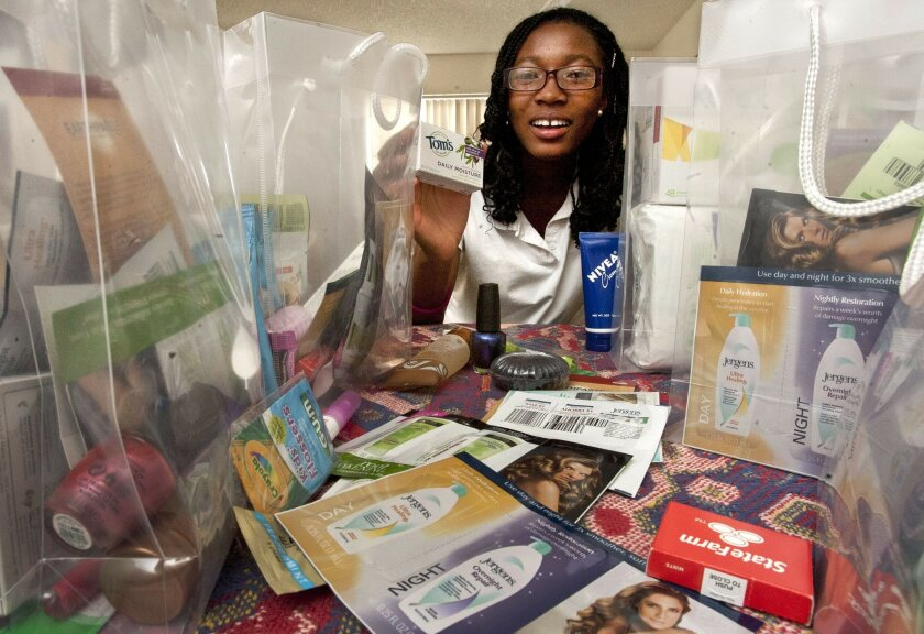 Kimberly Glover, 16, of Menifee, shows some of the toiletries she has collected and bagged to distribute to needy people.
