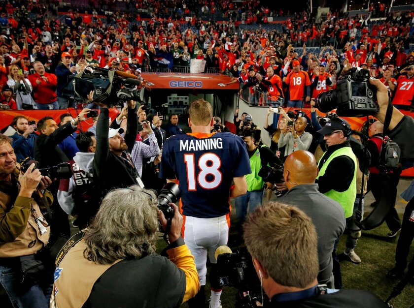 Denver Broncos quarterback Peyton Manning (18) leaves the field after an NFL football game against the Green Bay Packers, Sunday, Nov. 1, 2015, in Denver. With the win, Manning tied Brett Favre with the most wins in NFL history by a starting quarterback with 186. The Broncos won 29-10 to improve to