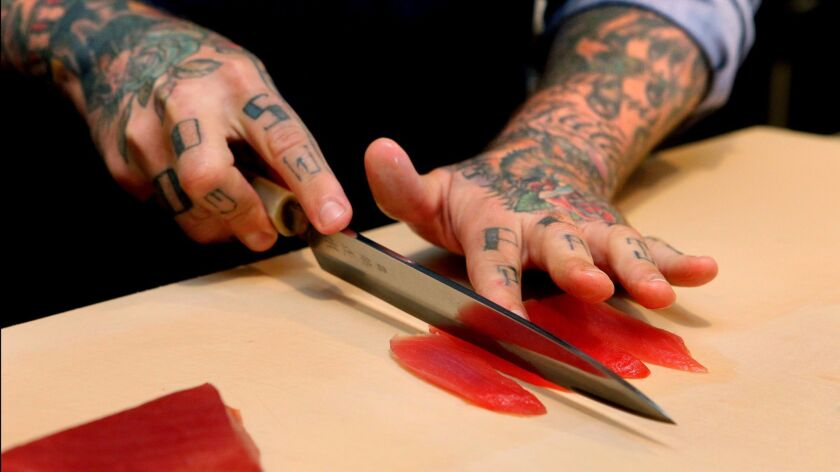 Chef Rob Ruiz slices tuna for a sushi dish at his The Land & Water Co. restaurant in Carlsbad in this 2014 photo.
