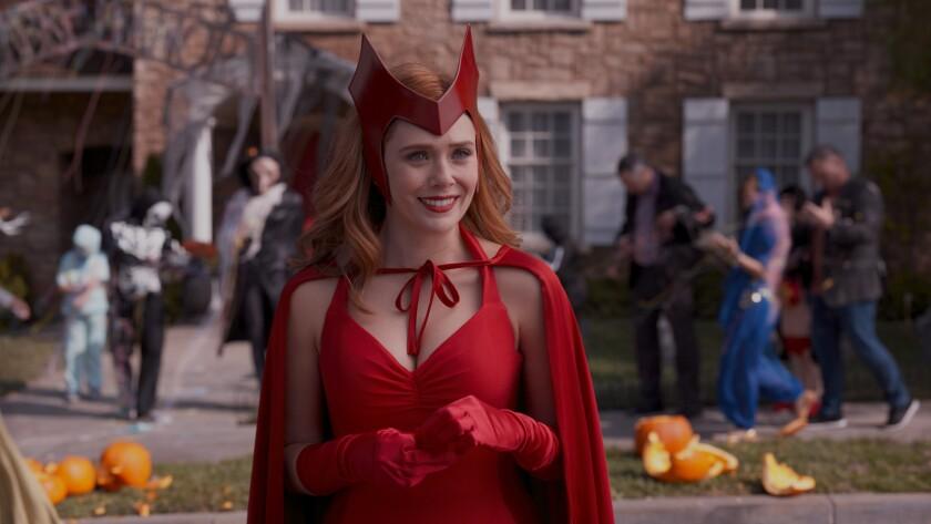 Elizabeth Olsen in costume in a Halloween scene on set.