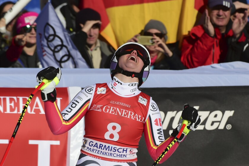 Germany's Viktoria Rebensburg reacts as she crosses the finish line of an alpine ski, women's World Cup downhill, in Garmish Partenkirchen, Germany, Saturday, Feb. 8, 2020. (AP Photo/Marco Tacca)