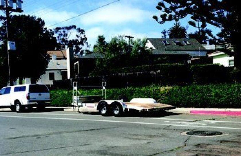 An oversized trailer is parked in La Jolla.