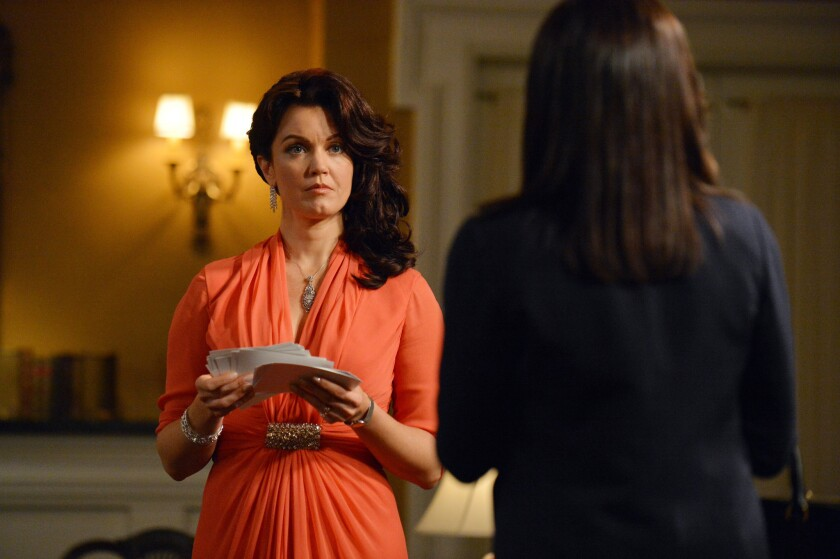 """Bellamy Young, left, as Mellie Grant, and Kerry Washington, as Olivia Pope, in a scene from """"Scandal."""""""