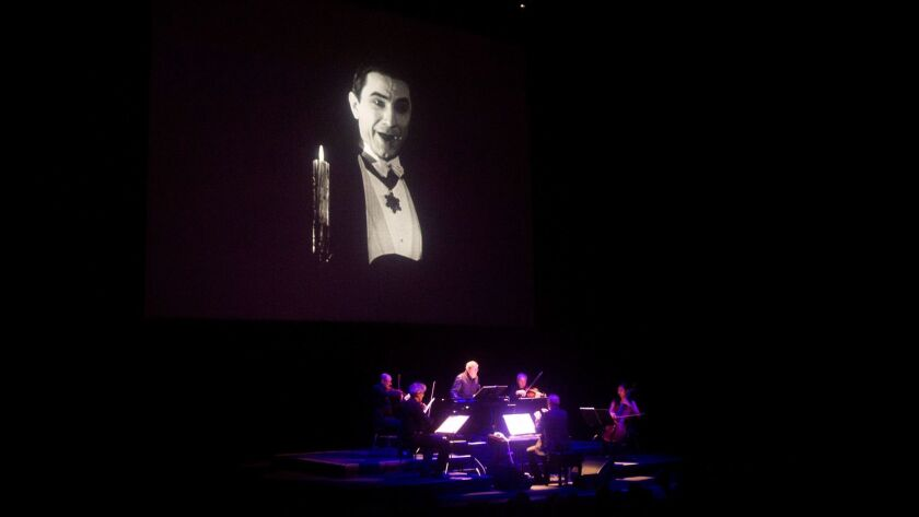 "Philip Glass and Kronos Quartet perform the score of ""Dracula"" at the Segerstrom Center for the Arts on Saturday"