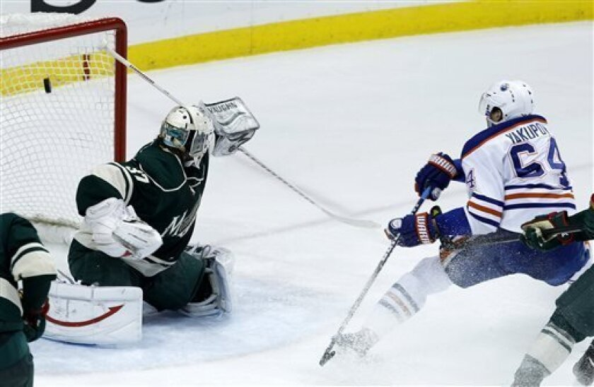 Edmonton Oilers right wing Nail Yakupov (64), of Russia, scores on Minnesota Wild goalie Josh Harding (37) during the second period of an NHL hockey game in St. Paul, Minn., Friday, April 26, 2013. (AP Photo/Ann Heisenfelt)