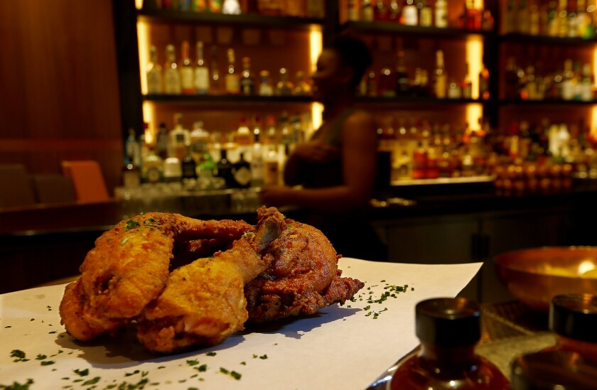 Fried chicken is a popular dish at Shaquille's, which adds Southern flair to the dining choices.