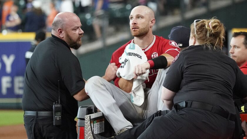 Angels catcher Jonathan Lucroy is carted off the field after Houston Astros baserunner Jake Marisnick collided with him at home plate July 7.