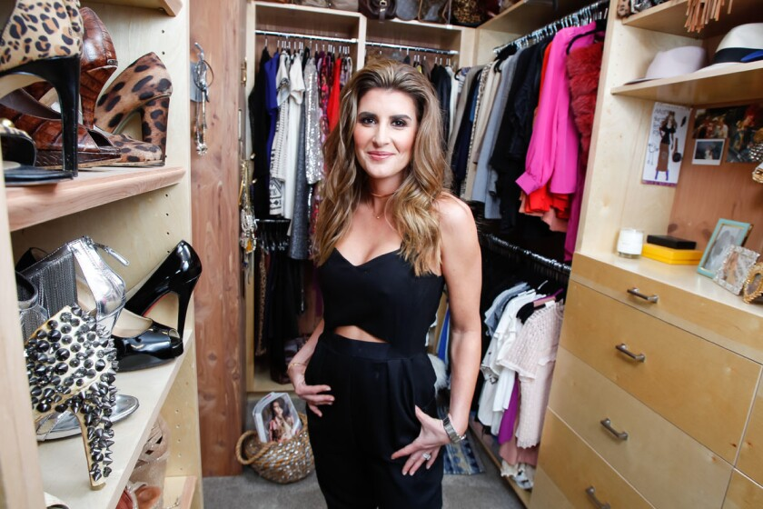Stylist Kristi Brooks in her closet at her home on Friday in Escondido, California. (Hair & makeup by Amanda Thorne-Pritchard; Photo by Eduardo Contreras / Union-Tribune)