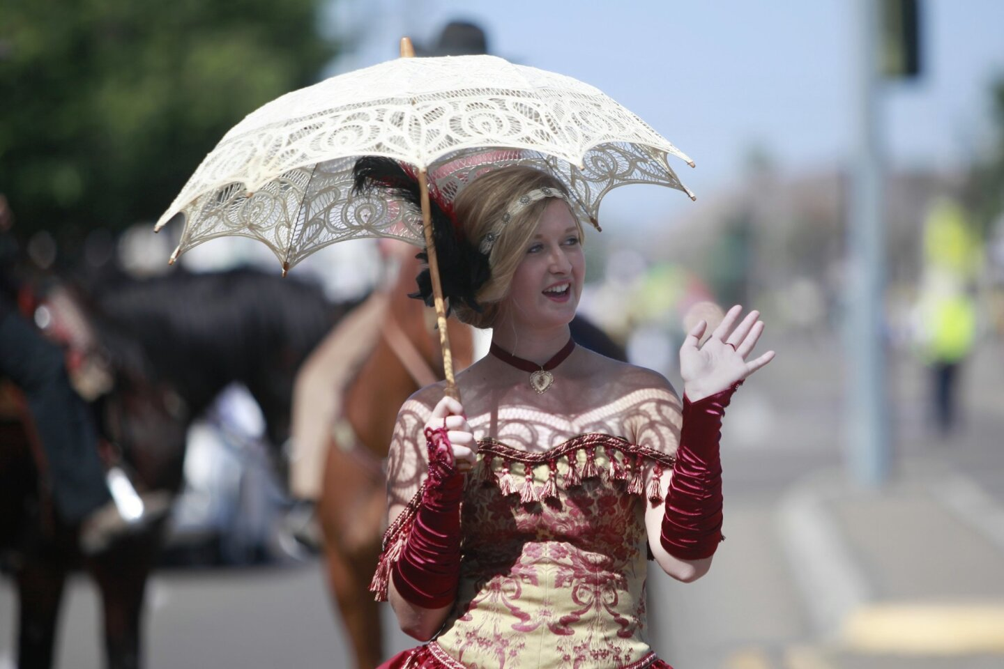 Allison Whitlow, 17, walked with a procession of wild west outlaws during the Annual Lakeside Western Days Parade Saturday morning.
