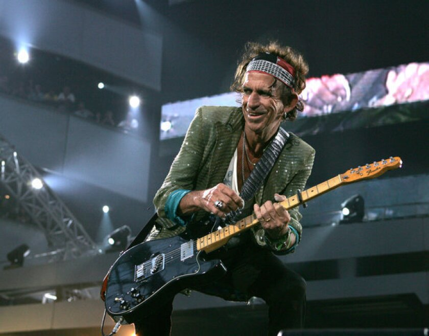 Keith Richards performs at a Rolling Stones concert in 2006.