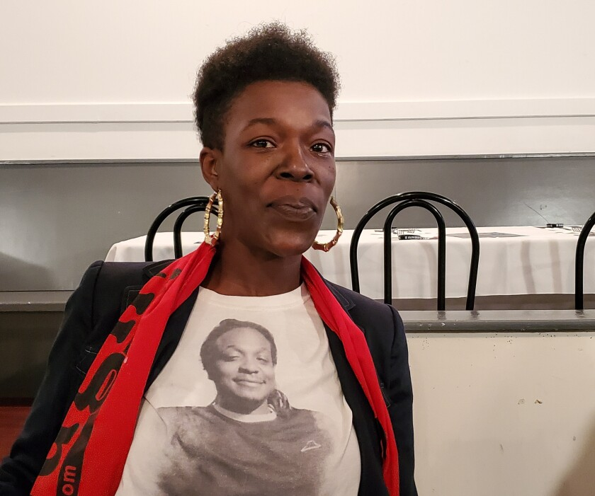 Erica Cokley of Charleston, 39, is a mother of three who attended a debate watch party in the city of North Charleston. She wore a t-shirt in honor of her late brother, Luther Jermaine Mitchell, who was killed in a shooting five years ago.