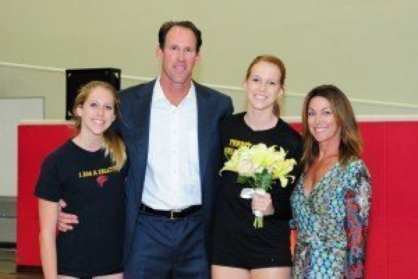 Reily Buechler (second from right) on Torrey Pines volleyball senior night with her family: sister Brynn, dad Jud and mom Lindsey. Photos/Anna Scipione