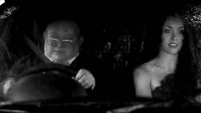 "In this image released by IFC Films, Laurence R. Harvey, left, and Ashlynn Yennie are shown in a scene from ""The Human Centipede 2."" (AP Photo/IFC Films)"