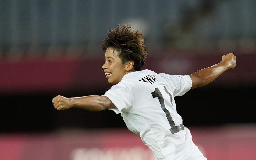 Japan's Mina Tanaka celebrates scoring her side's opening goal against Chile during a women's soccer match at the 2020 Summer Olympics, Tuesday, July 27, 2021, in Rifu, Japan. (AP Photo/Andre Penner)