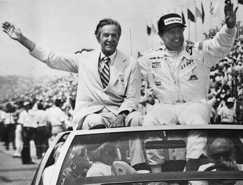 """In a May 29, 1977, photo provided by Indianapolis Motor Speedway, Tony Hulman, left, and A.J. Foyt wave to fans during a victory lap after Foyt won his fourth Indianapolis 500 auto race in Indianapolis.In the lead-up to the 100th running of the """"The Greatest Spectacle in Racing,"""" The Associated Pre"""