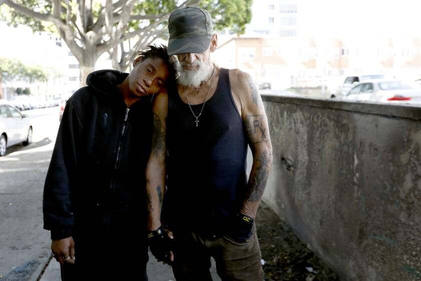 "Leslie Whittington Silvia, 43, left, with Tony ""Maddogg,"" 62, in L.A.'s Koreatown neighborhood on Sunday. Tony, who has colon cancer and has been homeless since 1989, lives in a tent near a temporary shelter that has been met with neighborhood opposition."