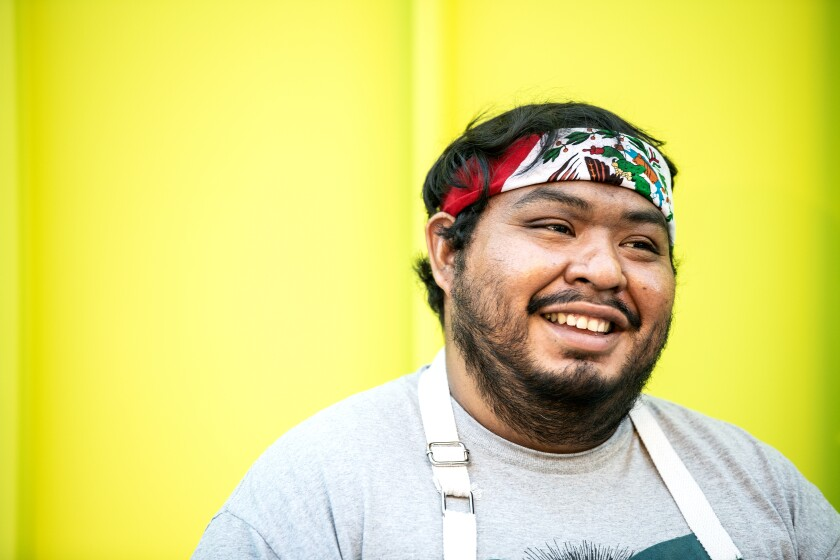 Chef Rogelio Hernandez poses for a portrait at Grand Park in downtown Los Angeles.