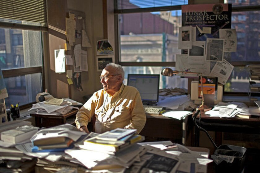 David Perlman sits at his desk at the San Francisco Chronicle, where he has been a reporter for 63 years. His favorite kind of story is equal parts physical adventure, scientific discovery and opportunity to watch brilliant researchers at work.