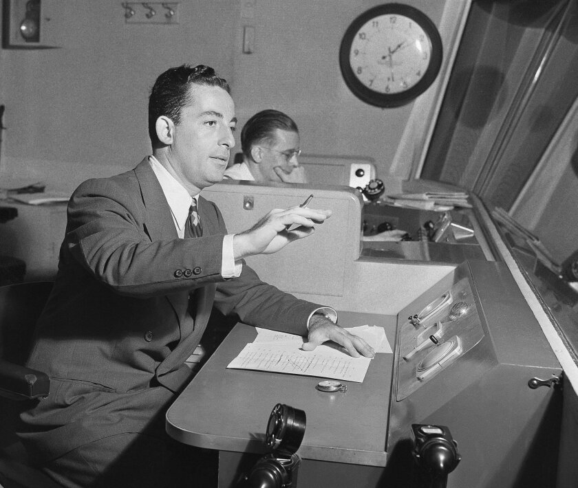 """FILE - In this August 1943 file photo, Himan Brown, right, works in a CBS radio studio in New York. Brown, a radio producer who lived in New York City and died in 2010 at age 99, put the bulk of his $100 million estate into a charitable trust controlled solely by his longtime lawyer, who some claim uses the money """"for his personal benefit, in disregard of the express intent of Brown's will and prior estate plan."""" A lawsuit filed on behalf of Radio Drama Network, Inc., a private foundation started by Brown in 1984, is challenging the attorney's control in Manhattan Surrogate's court. (AP Photo, File)"""