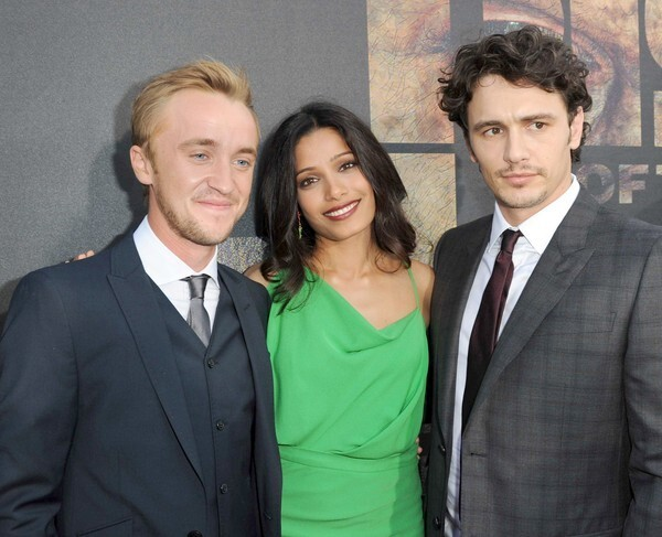 """Actors Tom Felton, left, Freida Pinto, and James Franco, who star in """"Rise of the Planet of the Apes,"""" arrive for the film's premiere at Grauman's Chinese Theatre in Hollywood. The film, an origin story for the """"Planet of the Apes"""" franchise, is set in present-day San Francisco."""