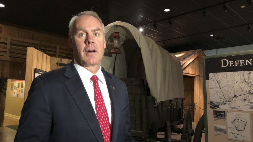 U.S. Interior Secretary Ryan Zinke speaks with reporters at the Camp Nelson National Monument on Sat