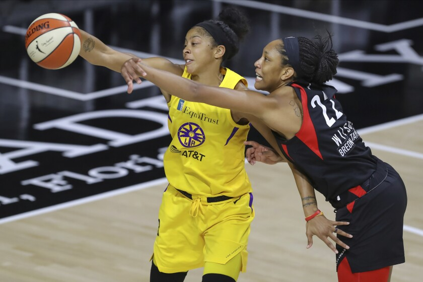 Aces forward A'ja Wilson deflects a pass intended for Sparks forward Candace Parker during their game Sept. 12, 2020.