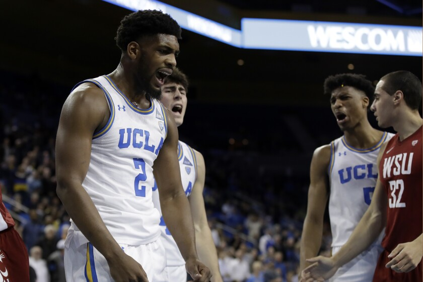 UCLA forward Cody Riley celebrates after blocking a shot during overtime of a game against Washington State on Feb. 13 at Pauley Pavilion.