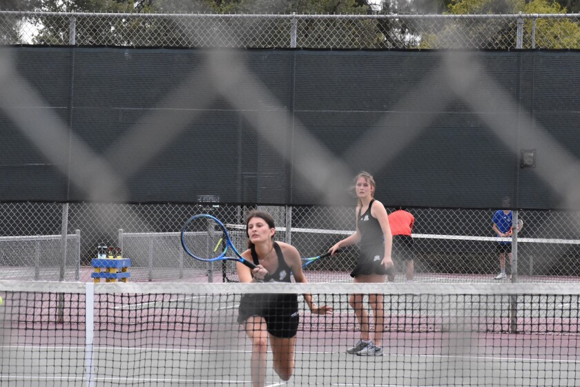 Ryan Din, in front, and Michaela Pierce, both Ramona High seniors, won the Valley League girls doubles championship.