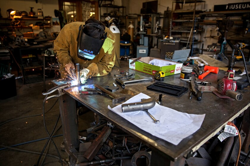 Marcos Ramirez, head of prototype and fabrication, welds a part for the Altwork Station.