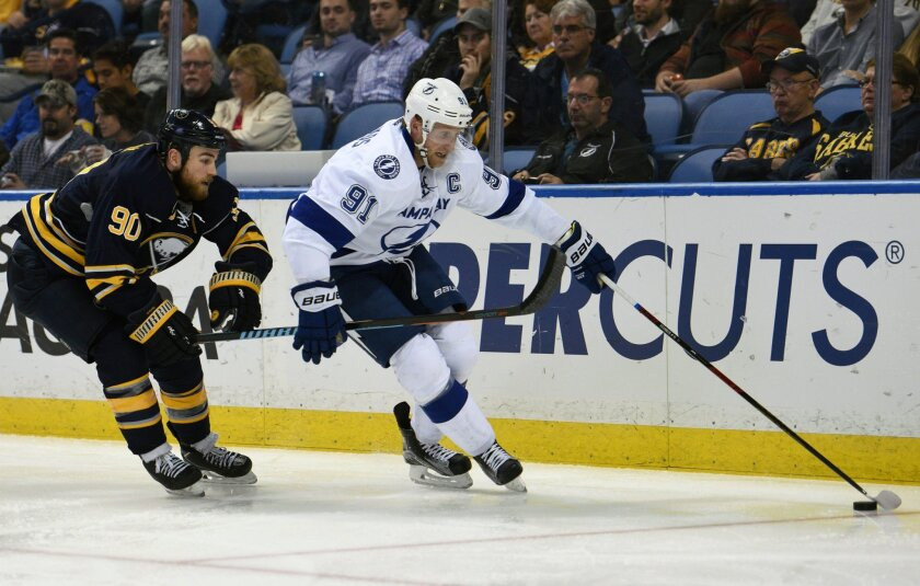 Buffalo Sabres center Ryan O'Reilly (90) battles for the puck with Tampa Bay Lightning center Steven Stamkos (91) during the second period of an NHL hockey game, Thursday Nov. 5, 2015, in Buffalo, N.Y. (AP Photo/Gary Wiepert)