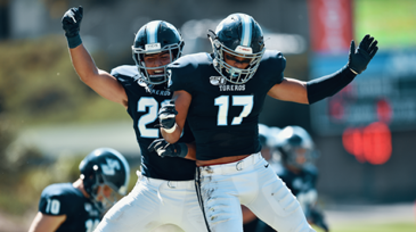 The Toreros celebrate after holding on to beat Harvard for USD's first win of the season Saturday, Sept. 21, 2019, at Torero Stadium.