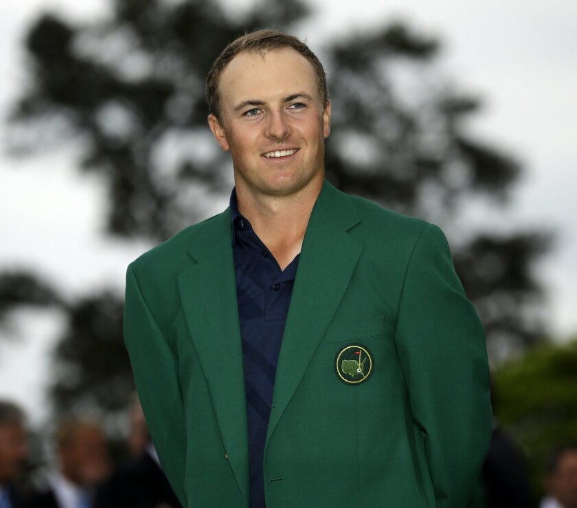 Jordan Spieth poses with his green jacket after winning the Masters golf tournament Sunday, April 12, 2015, in Augusta, Ga. (AP Photo/David J. Phillip)
