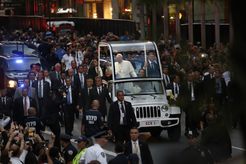 Pope Francis arrives at St. Patrick's Cathedral in Manhattan to an enthusiastic crowd.