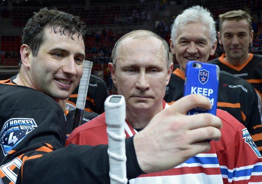 Roman Rotenberg, Vladimir Putin and Gennady Timchenko