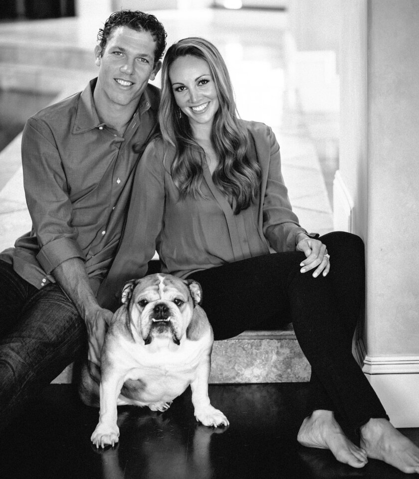 Basketball player and San Diego native Luke Walton with fiancee Bre Ladd, with their dog, Gus, when he proposed last Christmas.